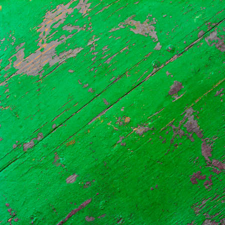 fractures: background texture of the old ultra green painted board in the cracks. square photo with copy space for text Stock Photo