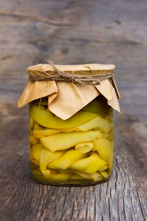 marinated green beans in a glass jar closeup. home canning. Armenian food Stock Photo