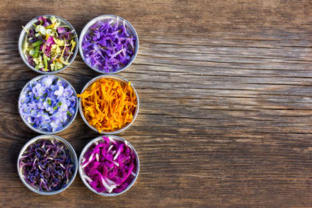 wooden aromatherapy: a set of fresh and colorful dried flower petals. aromatherapy, herbal tea, homeopathic medicine. Free space for text. Copy space Stock Photo