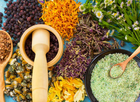 A set of dried flowers and berries, herbs, oak bark, sea salt on old wooden table. Alternative medicine, homeopathy Stock Photo - 59224103