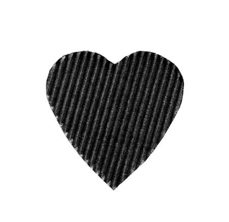 heavy heart: the symbol of a heart cut from corrugated cardboard black color isolated on white background. the concept of love, Valentines day
