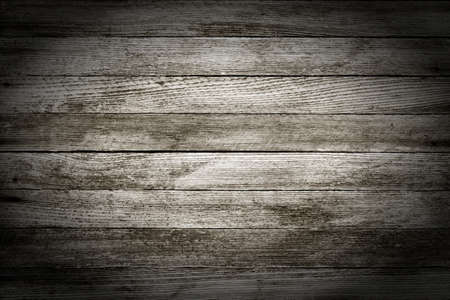barn black and white: background texture of old gray wooden barn boards with vignette. black and white photo