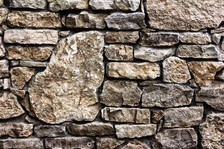 furred: Background texture of a wall built of stone, toned photo Stock Photo