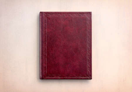 tinted: book red on a pink background, top view. tinted photo