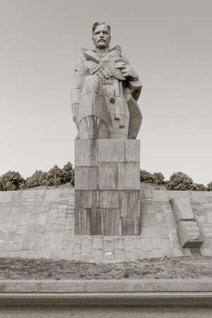 highway 3: NOVOROSSIYSK, RUSSIA - AUGUST 3, 2016: a monument to the sailors of the revolution near the highway in Novorossiysk city in summer, Russia. black and white monochrome photo