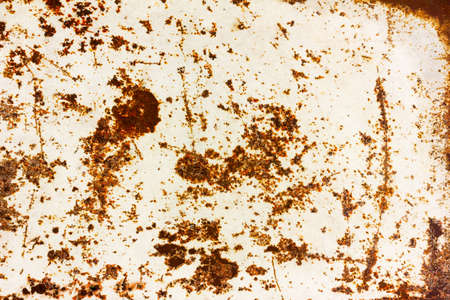 ferruginous: grunge background texture of painted white iron with rust spots Stock Photo