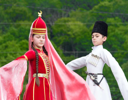 ADYGEA, RUSSIA - JULY 25 2015: Adyghe girl and boy in national costume on the Circassian ethnic festival in Adygeya