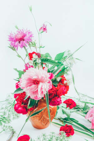 floral design. beautiful bouquet of pink flowers peons, cornflowers and red roses tinted photo Stock Photo