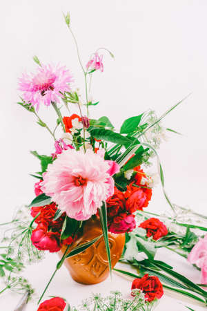 Floral design. A beautiful bouquet of pink peonies, cornflowers and red roses, toning photo Stock Photo