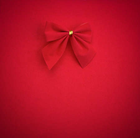 red bow on red background with vignette. mock up for text, congratulations, phrases, lettering