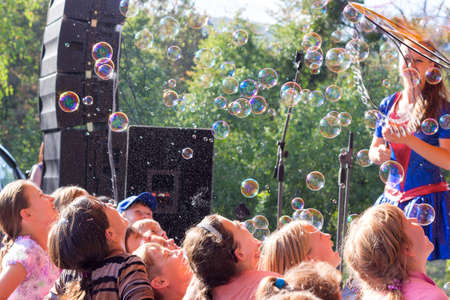 Adygea, Russia - September 2, 2017:  happy children and soap bubble show