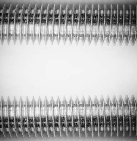 industrial background with a steel thread on the stud on grey background monochrome photo. mock up for text, phrases, lettering