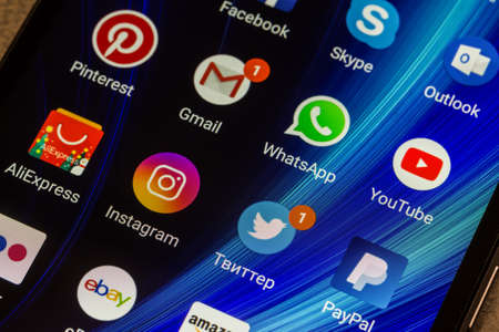 Adygea, Russia - January 3, 2018: WhatsApp, YouTube, instagram, Facebook, Skype and other app icons on the smartphone screen Xiaomi Editorial