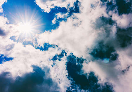 bright sun is closed by clouds Stock Photo