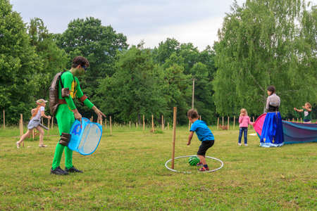 Adygea, Russia - June 1, 2018: Animators play with children in outdoor games on a childrens holiday on a summer day in Adygea