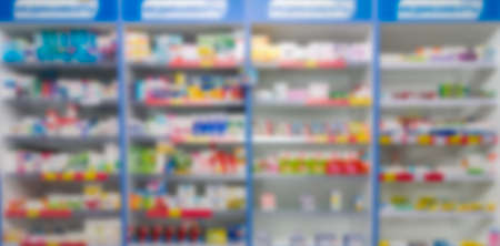 abstract background blur shelf with medicines and other goods in pharmacy store