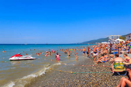 Sochi, Russia - August 21, 2018:black sea beach with vacationers in the summer