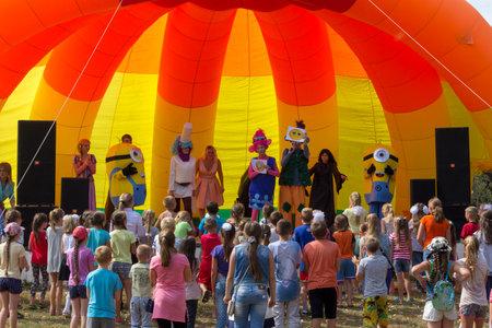 Kamennomostsky, Russia - September 1, 2018: Animators on stage entertain children at the festival day of the village of Kamennomostsky in the autumn park