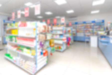 Fondo abstracto borroso con tienda, farmacia, minimercado