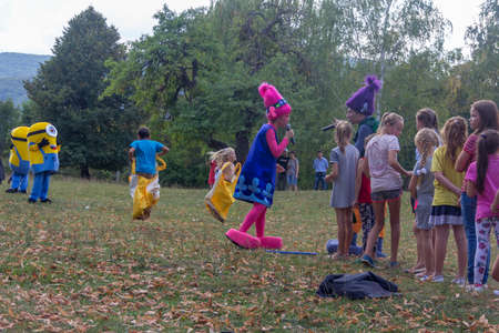 Kamennomostsky, Russia - September 1, 2018: Holiday day of the village Kamennomostsky with animators and children's playgrounds and competitions in the park in the fall