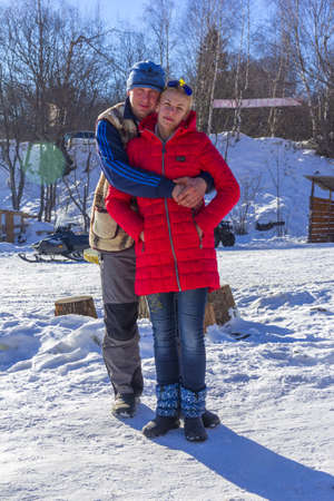 Adygea, Russia - January 23,  2017: a young guy hugs a girl on a winter day at a ski resort Stock Photo - 114570182