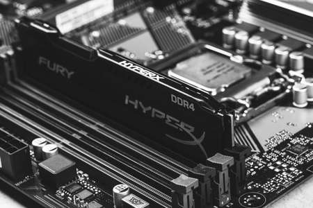 Maykop, Russia - November 9, 2018: black DDR 4 DIMM 16 Gb Kingston HyperX Fury Memory RAM Module in the slot on the motherboard Asus closeup, black and white photography Editorial