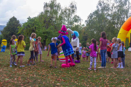 Kamennomostsky, Russia - September 1, 2018: Holiday day of the village with animators and children's playgrounds and competitions in the park in the fall Stock Photo - 114570352