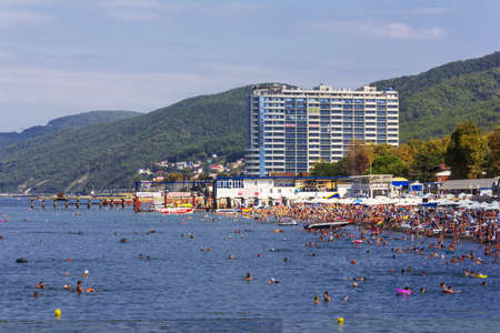 Sochi, Russia - August 22, 2018: City beach with tourists resting on a summer day