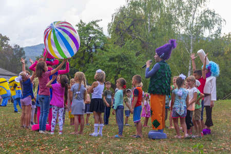 Kamennomostsky, Russia - September 1, 2018: Holiday day of the village with animators and childrens playgrounds and competitions in the park in the autumn