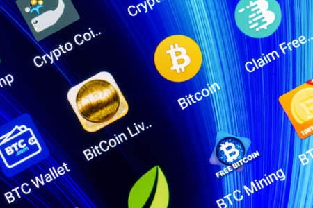 Adygea, Russia - February 12, 2018: mobile application for bitcoin on the smartphone screen Editorial