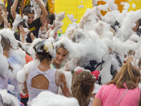 Kamennomostsky, Russia - September 1, 2018: Happy children having fun at a foam party at a holiday town day in an autumn park Stock Photo - 114570358