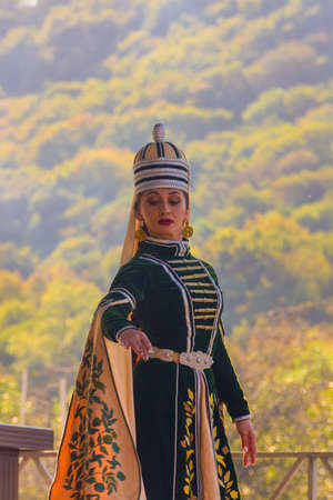 Dakhovskaya, Russia - September 22,  2018: portrait a young girl in traditional Circassian clothes dances at the festival of Adyghe cheese in the foothills of the Caucasus Stock Photo - 114570362