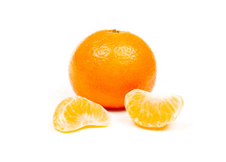 ripe juicy tangerine in the peel and in slices isolated on white background close-up Stock Photo - 114612445