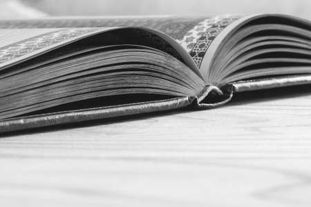 open book on the wooden table with copy space, selective focus and shallow depth of field, black white photography Stock Photo - 114612493