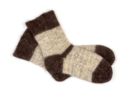 male grey knitted socks of dog fur on white background close-up, top view Stock Photo - 114612499