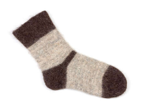 single male grey knitted sock of dog fur on white background close up, top view Stock Photo - 114612502