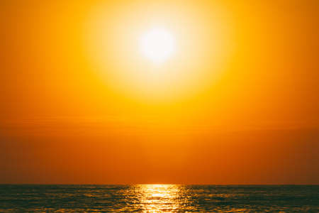 summer sea landscape with orange sky at sunset