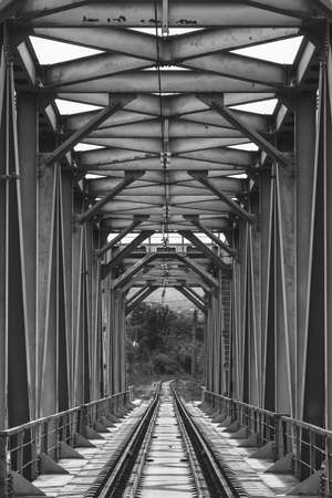 industrial landscape with railway bridge, black white photo