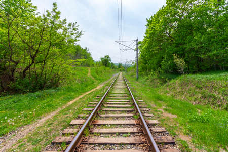 railway rails with wooden sleepers on a summer or spring day Stock Photo