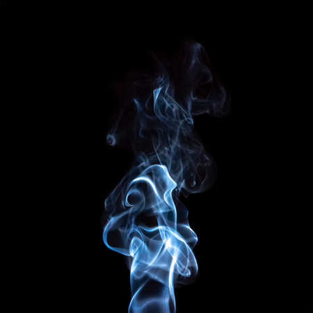 plume of blue smoke isolated on black background