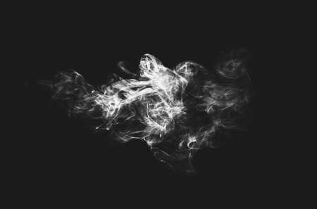 cloud of smoke on a black background, black and white photo