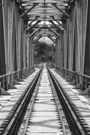 industrial landscape with railway bridge, black and white photo Stock Photo