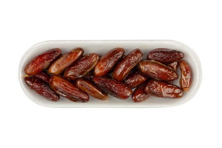 dried dates in white packaging isolated on white background close-up, top view