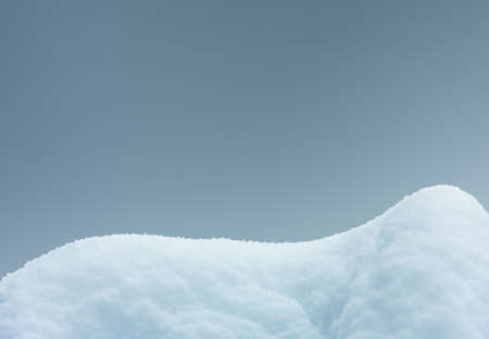snowdrift isolated on gray blue background close-up with copy space Imagens