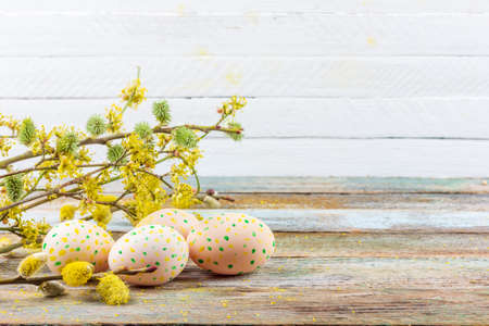 spring Easter still life of flowering willow branches, dogwood and eggs on an old wooden retro background with copy space Stock Photo