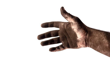 male chimney sweep's hand in black soot close up isolated on a white background Foto de archivo