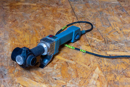 soldering iron for polypropylene pipes on the floor close up