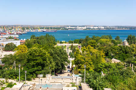 Kerch, Russia - 13 August 2019: summer landscape with a view of the sea port and the city of Kerch from mount Mithridates