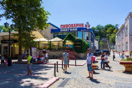 Kerch, Russia - 13 August 2019: tourists pedestrians in the center of the southern resort city of Kerch on a summer day