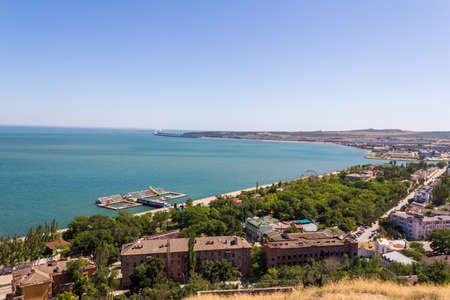 beautiful view of the black sea, the Crimean bridge and the embankment of the resort city of Kerch from mount mithridat on a summer day